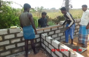 House construction in progress using fair-faced cement blocks