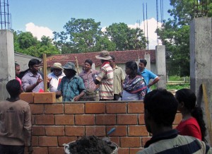 New community centre walls under construction with Mud Concrete Blocks.