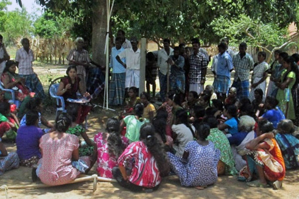 Community meetings were held outdoors as the village lacked a common building.