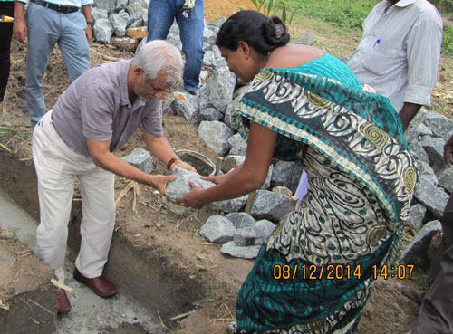 Laying the foundation stone for the house.