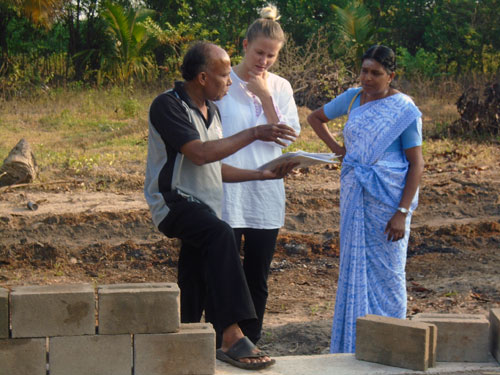 Discussing house construction with UN-Habitat staff.