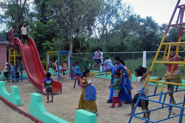 Children enjoying playtime in their new playground.