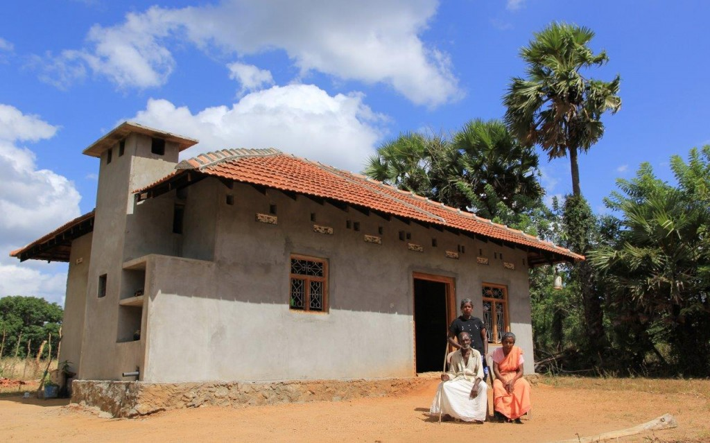 Sivasothi and her parents outside their new home.