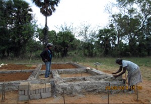 Sivasothi constructing the foundation.