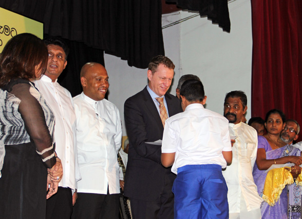 Mr. Tim McNair, Chief Technical Adviser of UN-Habitat Sri Lanka, awards a certificate to a winner of the World Habitat Day Children's Essay Competition.