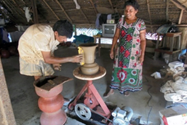 Mr. Muthuveeran Balachandran using the motorised pottery wheel.