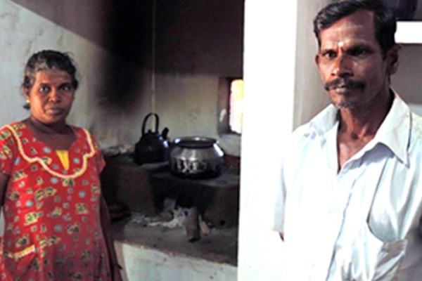 Mr. and Mrs. M. Somasundaram in their kitchen using the Anagi stove.