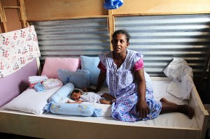 Swarnakanthi with her baby in their bedroom